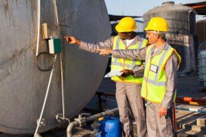 industrial engineers inspecting tank