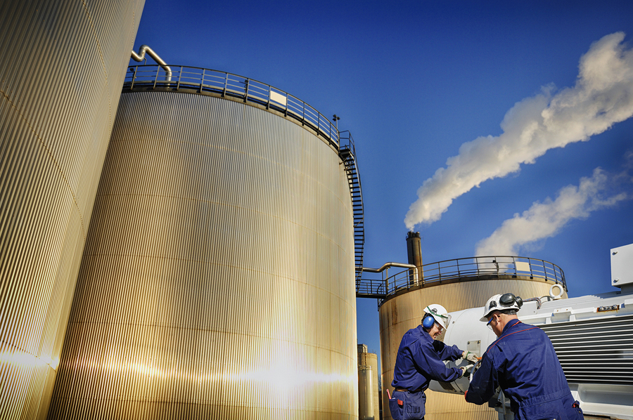 oil workers cleaning storage tanks